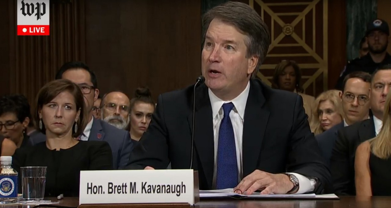 Panel OKs Kavanaugh, but delay urged for floor vote